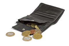 Loose cash falling out of black wallet Royalty Free Stock Photography