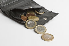 Loose cash falling out of wallet Royalty Free Stock Photo