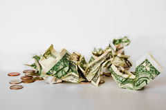 Loose Change. Crumbled dollars and loose change on a white background Stock Photography