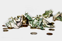 Loose Change. Crumbled dollars and loose change on a white background Royalty Free Stock Photos