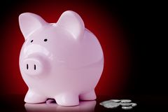 Loose change. Pink piggy bank with loose change Stock Photo