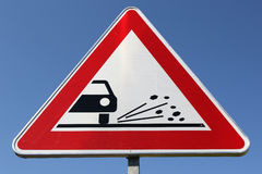 Loose chippings. German road sign: loose chippings royalty free stock photography