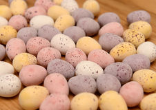 Loose Chocolate eggs on table stock photo