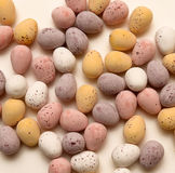 Loose Chocolate eggs on table Stock Image