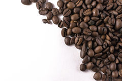 Loose Coffee Beans on White Background. Overhead shot of loose coffee beans on a white background with copyspace Stock Photography