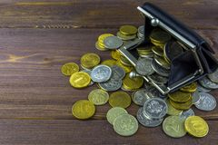 Loose coins on a wooden table. Wallet full of coins. Russian coins - rubles. stock images