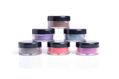 Loose eye shadows in transparent jars Royalty Free Stock Images