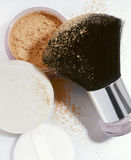 Loose face powder. With brush and make up puff stock photography