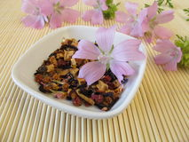 Loose fruit tea with mallow flowers. In little bowl Royalty Free Stock Photos