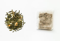 Loose green tea and teabag Royalty Free Stock Photo