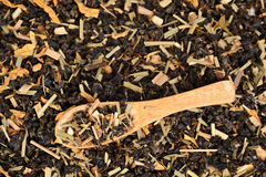 Loose leaf organic tea in wood spoon Royalty Free Stock Images