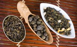 Loose leaf tea. Three different heaps of loose leaf tea in causers Royalty Free Stock Photos