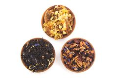 Loose Leaf Tea. In a Wooden Bowls on a White Background stock images