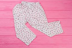Loose pants on pink background Royalty Free Stock Image