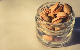 Pistachio nuts in a glass container stock photography