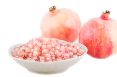 Loose pomegranate (Punica granatum) seeds in a bowl shot on whit Royalty Free Stock Photos