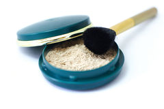Loose powder. Powder brush with loose powder Stock Images