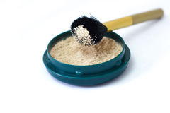 Loose powder. Powder brush with loose powder Royalty Free Stock Image