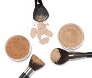 Loose powder and compact powder with makeup brushes Royalty Free Stock Image