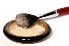 Loose Powder with Kabuki Brush. Container of loose powder with kabuki brush Royalty Free Stock Images