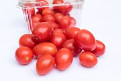 Loose roma cherry tomatoes. On the white background Royalty Free Stock Photography