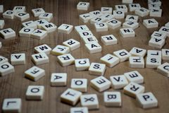 Loose letters of scrabble game stock images