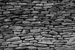 Loose Stone Built Wall. Black and white stone built wall background royalty free stock photography