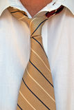 Loose tie. Man with loosened collar and tie stock image