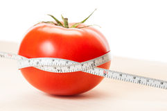 Loose weight with red tomatoes diet concept Royalty Free Stock Photo