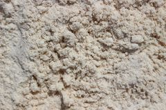 White loosened sand background. Loose white sand on the beach. View from above. Can be used as a background. Artistic texture for marine themes. Can be used as Royalty Free Stock Images