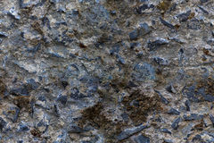 Loosely cemented rock wall, edited for seamlessly tileable/repea. Loosely cemented rock wall texture, edited to be seamlessly tileable / repeatable. Taken at Royalty Free Stock Photography