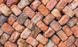 Colorful wall of loosely piled bricks. Loosely stacked brick wall at an old brick factory in Belgium Stock Image