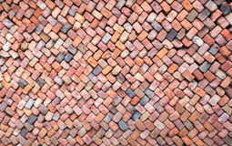 Colorful wall of loosely piled bricks. Loosely stacked brick wall at an old brick factory in Belgium Stock Photography