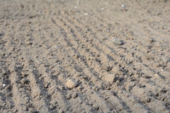 Loosened soil texture. Photo of loosened soil with blurred foreground and background. Shallow depth of field Royalty Free Stock Photography