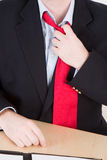 Loosening a red tie. A business man loosening his red tie after a hard meeting Stock Image