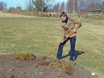 Loosening soil by rake 2 Stock Images