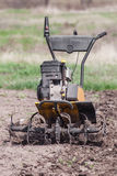 Loosens the soil cultivator front view Royalty Free Stock Photography
