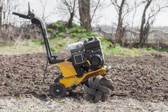 Loosens the soil cultivator side view Royalty Free Stock Images