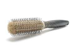Loosing hair concept hairbrush with hairs on the white background with copyspace. Hairbrush with lots of hairs royalty free stock image
