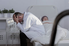 Loosing a patient. Picture of a sad doctor grieving his patient royalty free stock photography