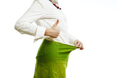 Loosing weight. Woman demonstrating effects of a diet, loosing weight royalty free stock images