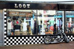 Loot shop with a nice Chopper in front Stock Photography