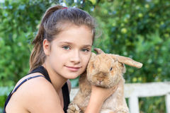 Lop-Eared Rabbit. A girl holds a Aries rabbit Stock Photos