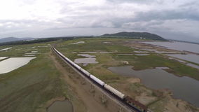 Aerial view of train crossing bridge in thailand