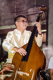 Lopburi, Thailand : Man playing bass. Royalty Free Stock Image