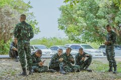 LOPBURI THAILAND, MARCH 24, 2019 : Thai cadets relax after completing the parachute training at Ban Tha Duea Drop Zone on March 24 stock photography