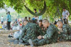 LOPBURI THAILAND, MARCH 23, 2019 : Thai cadets relax after completing the parachute training at Ban Tha Duea Drop Zone on March 23 royalty free stock images