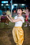 Lopburi, Thailand : Woman blowing Fruita. Royalty Free Stock Photography
