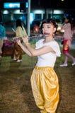 Lopburi, Thailand : Woman blowing Fruita. Royalty Free Stock Photography