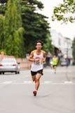 Lopende atleet in mini-marathonras Royalty-vrije Stock Afbeeldingen
